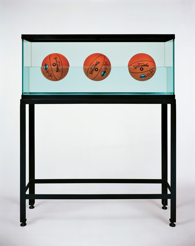 Jeff Koons. Three Ball 50-50 Tank (Spalding Dr. JK Silver Series), 1985. Glass, steel, distilled water, three basketballs, 60 1/2 x 48 3/4 x 13 1/4 in (153.7 x 123.8 x 33.7 cm). Edition of 2. © Jeff Koons.