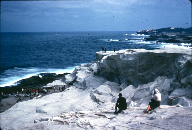 A photo of Kaldor Public Art Project 1: Christo and Jeanne-Claude's Wrapped Coast – One Million Square Feet taken by art education lecturer Ellen Waugh in 1969. Ellen used her photographs as slides for teaching. These slides were scanned and new colour photographs of the legendary project were discovered last year.
