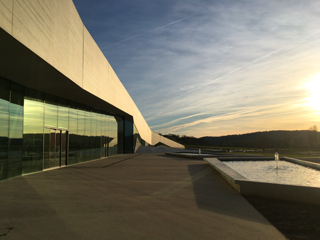 The glazed façade of Lascaux IV at dusk. Photograph: Veronica Simpson.