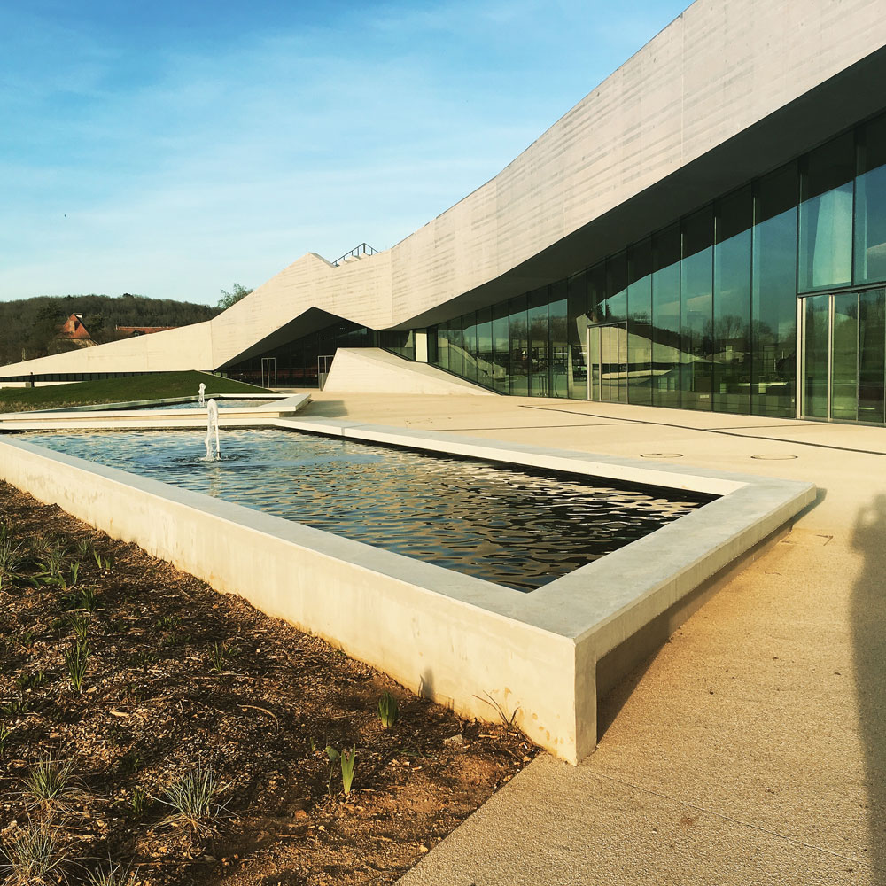 Two pools reflect the façade and the Dordogne sky. Photograph: Veronica Simpson