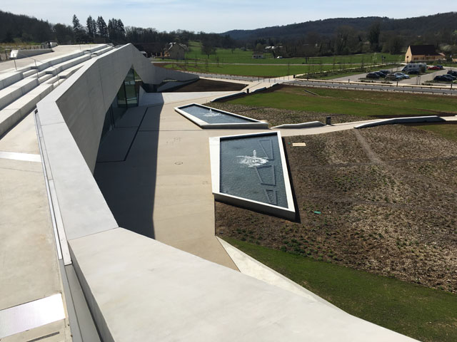 Up on the rooftop walkway, you can see the way the building nestles into the hill, opening out onto the town.