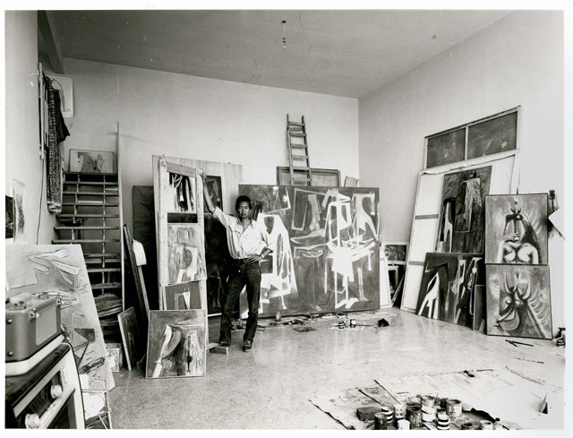 Wifredo Lam in his studio in Albissola in 1964. In the centre is The Soulless Children, 1964. Wifredo Lam Archives. © SDO Wifredo Lam.