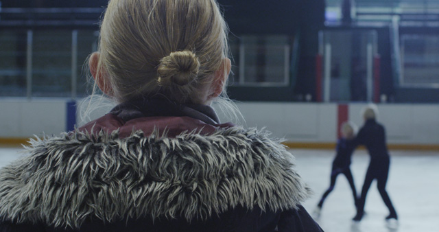 Liz Magic Laser. Kiss and Cry, 2015. Single-channel 4K video, 13 min 30 sec, video still (1). Featuring figure skaters Anna MacKenzie and Axel MacKenzie and coach Marie Jonsson MacKenzie. Commissioned and produced by Mercer Union.