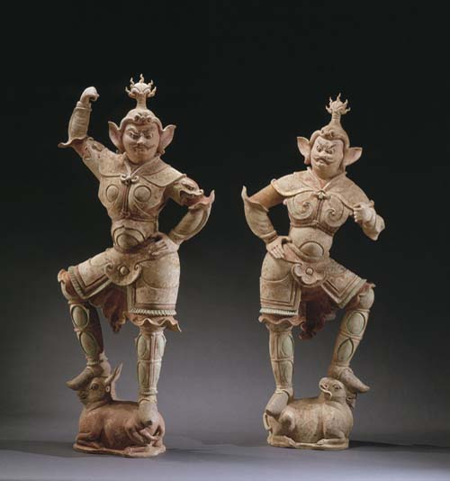 A PAIR OF LARGE PAINTED POTTERY FIGURES OF LOKAPALAS. Tang dynasty, late 