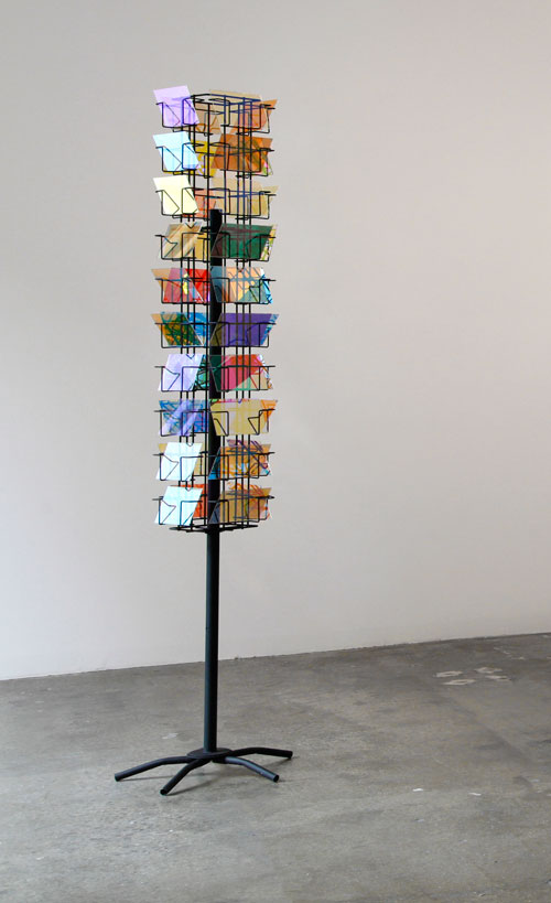Stephen Dean. Prayer Mill, 2009. Metal structure and dichroic glass, (40 panels of 4 x 6 in) 72 x 10 in x 10 in.