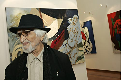 MF Husain in front of painting depicting Ocean Queen Rocks the Ship