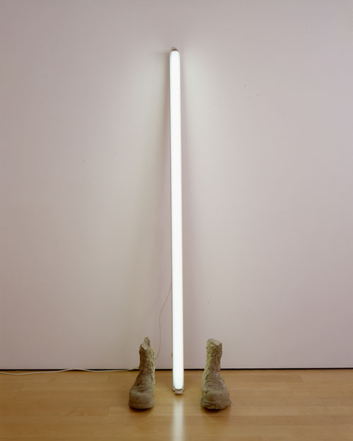 Sarah Lucas. Unknown Soldier, 2003. Concrete boots, neon tube, 183 x 58 x 36 cm. Copyright the artist, courtesy Sadie Coles HQ, London.