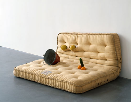 Sarah Lucas. Au Naturel, 1994. Mattress, water bucket, melons, oranges and cucumber, 84 x 168 x 145cm. Copyright the artist, courtesy Sadie Coles HQ, London.