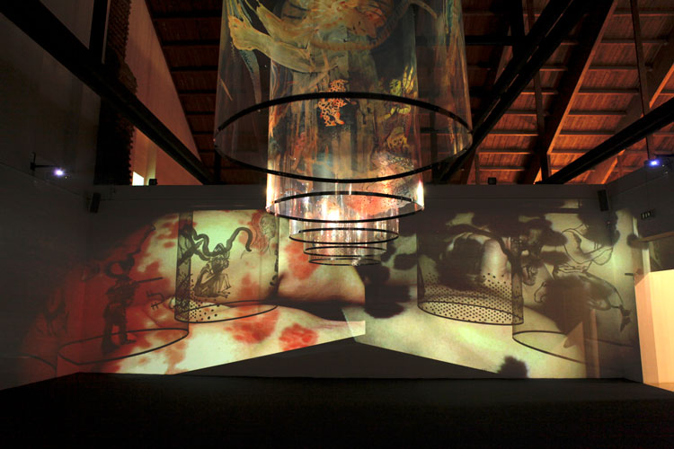 Nalini Malani, In Search of Vanished Blood, 2012. Six channel video/shadow play with five reverse painted Mylar cylinders, sound, 11 minutes. Installation view: Nalini Malani: The Rebellion of the Dead-Part II, Castello di Rivoli Museum of Contemporary Art, Rivoli, 2018. Collection: Burger Collection, Hong Kong. © Nalini Malani.