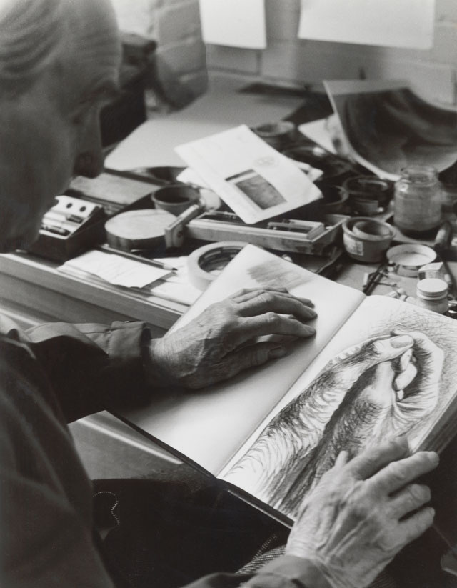 Moore with The Artist's Hands c1974, a page from Red Notebook 1969-77, in Gildmore Graphics Studios, Perry Green, 1976. Reproduced by permission of The Henry Moore Foundation. © The Henry Moore Foundation. Photo: Bo Boustedt.