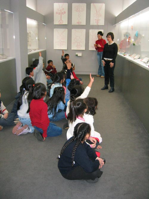 Artist, educator and children. Courtesy Museum of Art and Design.