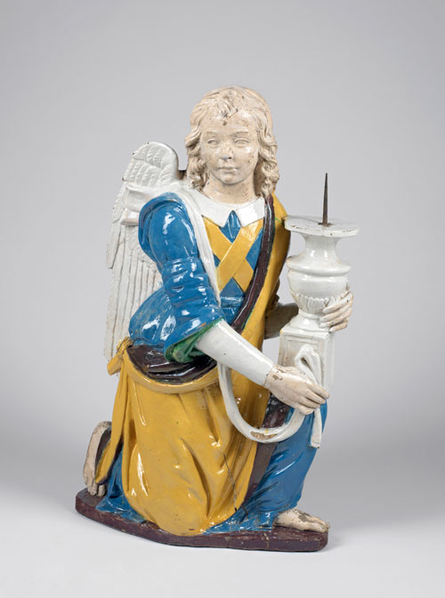 Della Robbia family (active 15th – 16th centuries). Kneeling Angel holding a Candlestick, about 1500-50. Terracotta, painted with lavender-blue, green, yellow, manganese-purple and white tin-glazes. Lent by the Syndics of The Fitzwilliam Museum, Cambridge