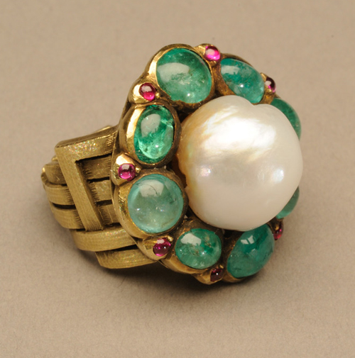 Marie Zimmermann. Ring, by 1922. Gold, baroque pearl, emeralds, pink sapphires and possibly rubies, 1 x 1 in (2.5 x 2.5 cm). Private collection. Photograph: David Cole © American Decorative Art 1900 Foundation. Used by permission.