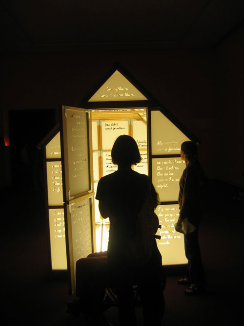 Mary Kelly and Ray Barrie. Love Songs, 2005&ndash;7. <em>Multi-Story House</em>, 2007. Wooden frame, cast acrylic panels, plate glass floor, fluorescent light, 244 x 183 x 244 cm. Courtesy Jose Carlos Teixeira and the artist. Collection of the artist.