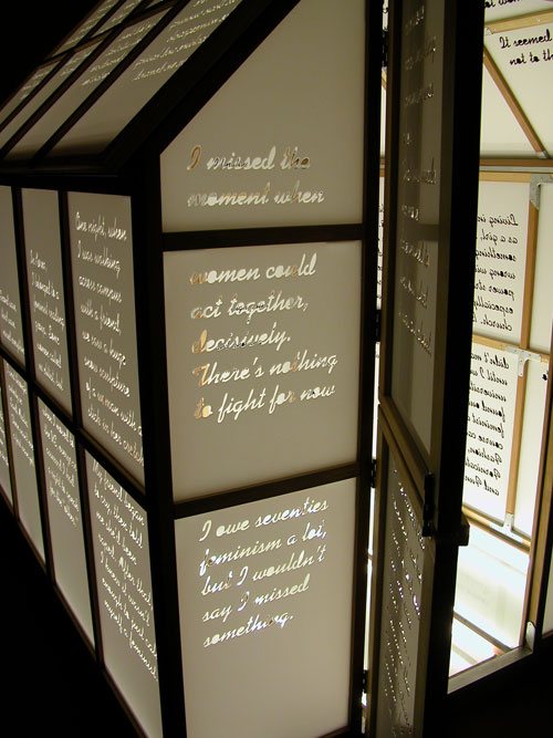 Mary Kelly and Ray Barrie. Love Songs, 2005–7. <em>Multi-Story House</em>, (detail) 2007. Wooden frame, cast acrylic panels, plate glass floor, fluorescent light, 244 x 183 x 244 cm. Courtesy Jose Carlos Teixeira and the artist. Collection of the artist.