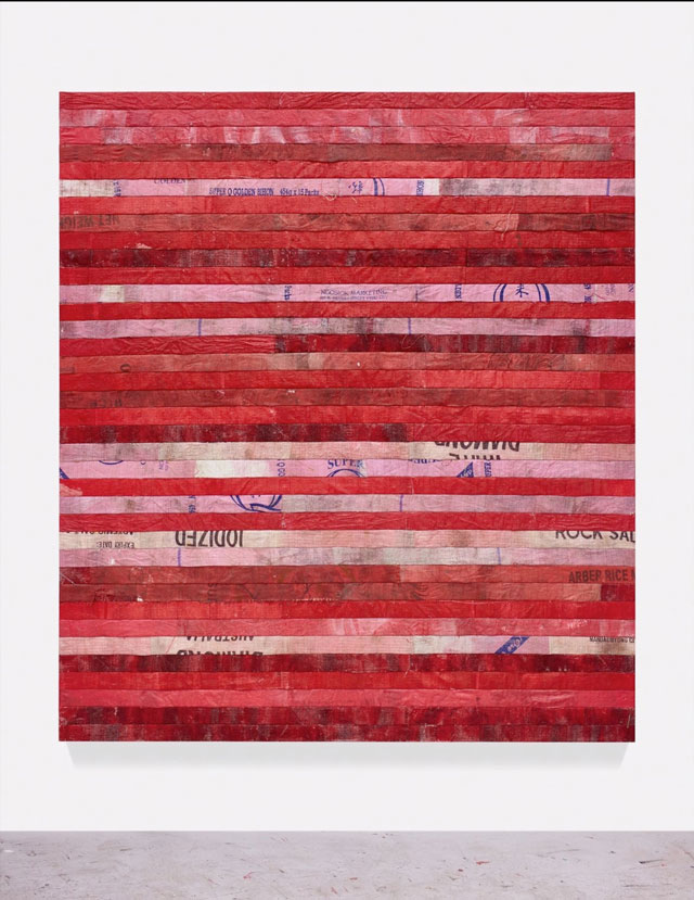Hugo McCloud. red line to Bataan, 2016. Used polyethylene sacks mounted to panel, 86 x 78 in (218.4 x 198.1 cm). © Hugo McCloud, courtesy: Sean Kelly, New York.