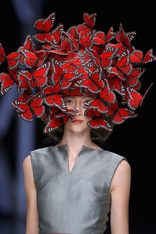 Butterfly headdress of hand-painted turkey feathers. Philip Treacy for Alexander McQueen. La Dame Bleue, S/S 2008. Model: Alana Zimmer © Anthea Simms.