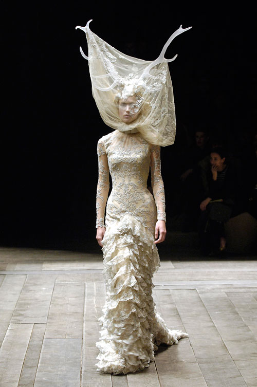 Alexander McQueen. Tulle and lace dress with veil and antlers, Widows of Culloden, A/W 2006–07. Model: Raquel Zimmermann, Viva London, Image: firstVIEW.