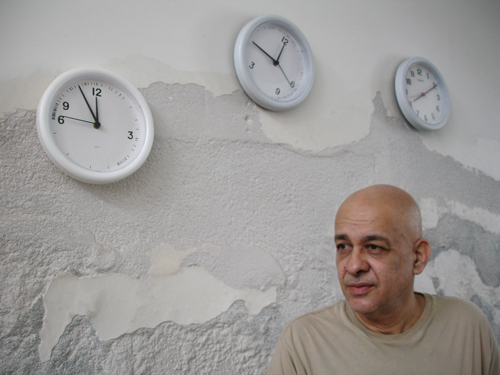 Cildo Meireles. The clocks in the background are part of Fontes (1992/2008) installation.