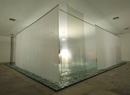 Cildo Meireles. <em>Through</em>, 1983–9/2008. Piece includes – Cellophane, aquarium, chicken wire, fishing nets, voile, glass, iron fencing, 600 x 1500 x 1500 cm. © Cildo Meireles