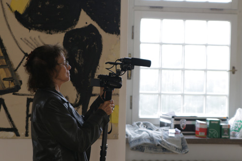 Susan Steinberg filming at Rose Wylie's exhibition at Städtische Galerie, Wolfsburg. Photographer: Sojo Yang.
