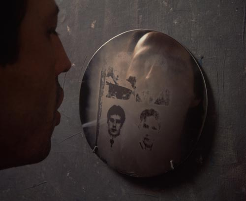 Oscar Mu&ntilde;oz. <em>Oscar Mu&ntilde;oz with Aliento (Breath)</em>, 1996-2002. Grease photo-silkscreen on steel discs, 20 cm each. Photograph &copy; Thierry Bal, 2008