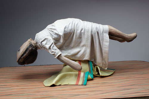 Cathie Pilkington. <em>Levitating Doll</em>, 2010. Wood, steel, clay, fabric, lino, paint 28 x 90 x 52 cm.  © the artist and Space Station Sixty-Five. Photo: Graham Challifour.