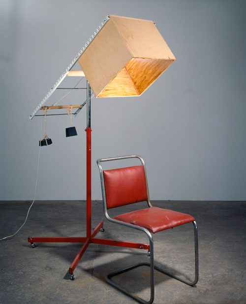 Sarah Lucas. <em>Portable Smoking Area</em>, 1996. Wood, chair, weights, chrome stand, shellac, 180 x 76 x 140 cm. Collection of Ursula Blickle. Copyright the artist, courtesy Sadie Coles HQ, London.