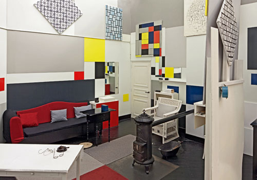 Reconstruction of Mondrian's studio at 26 rue du Depart, Paris based on 1926 Photo by Paul Delbo. © 2014 STAM, Research and Production: Frans Postma Delft-NL. Photograph: Fas Keuzenkamp. © 2014 Mondrian/Holtzman Trust c/oHCR InternationalUSA.
