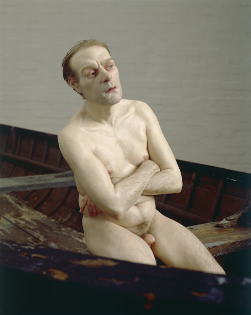 Ron Mueck. <em>Man in a Boat</em>, 2002. Mixed media. Man: (height) 75cm Boat: (length) 427cm © Ron Mueck, courtesy Anthony d'Offay, London. Photographer: Mike Bruce, Gate Studios, London.