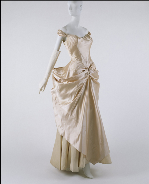 Charles James (American, born Great Britain, 1906–1978). Wedding Gown, 1948–49, pink silk satin and ivory taffeta.  Courtesy of The Metropolitan Museum of Art, Gift of Jane Love Lee, 1993.