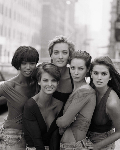 Naomi Campbell, Linda Evangelista, Tatjana Patitz, Christy Turlington, and Cindy Crawford in tops, 1990, by Giorgio di Sant'Angelo (American, born Italy, 1933–1989).  British Vogue, January 1990. Photograph by Peter Lindbergh (German, born 1944). Photograph courtesy of Peter Lindbergh.
