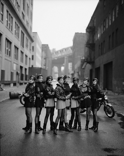 Cindy Crawford, Tatjana Patitz, Helena Christensen, Linda Evangelista, Claudia Schiffer, Naomi Campbell, Karen Mulder, Stephanie Seymour in Gianni Versace (Italian, 1946-1997), Autumn/Winter 1991–1992. Vogue, September 1991. Photograph by Peter Lindbergh (German, born 1944). Photograph courtesy of Peter Lindbergh.
