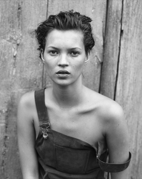 Kate Moss in overall dress, 1994, by Anna Molinari Blumarine (Italian, founded 1977).  Harper's Bazaar, December 1994. Photograph by Peter Lindbergh (German, born 1944). Photograph courtesy of Peter Lindbergh.
