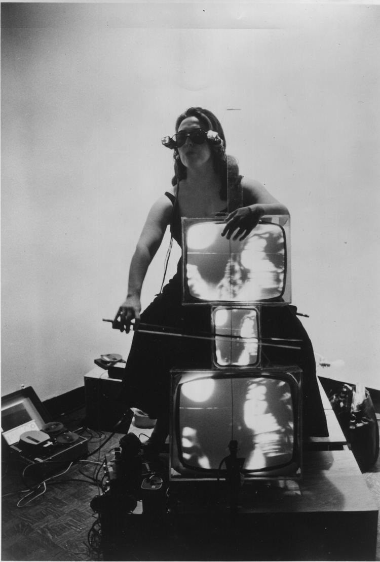 Nam June Paik. Charlotte Moorman with TV Cello and TV Eyeglasses, 1971. Photograph, gelatin silver print. Lent by the Peter Wenzel Collection, Germany.