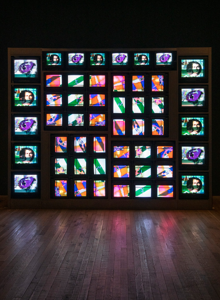 Nam June Paik. Internet Dream 1994. Install view, Tate Modern 2019. Ten 20-inch cathode-ray tube televisions, forty-two 13-inch cathode-ray tube televisions,custom-made video wall system, steel frame and three video channels, colour, sound, 287 x 380 x 80 cm. ZKM Centre for Art and Media, Karlsruhe.