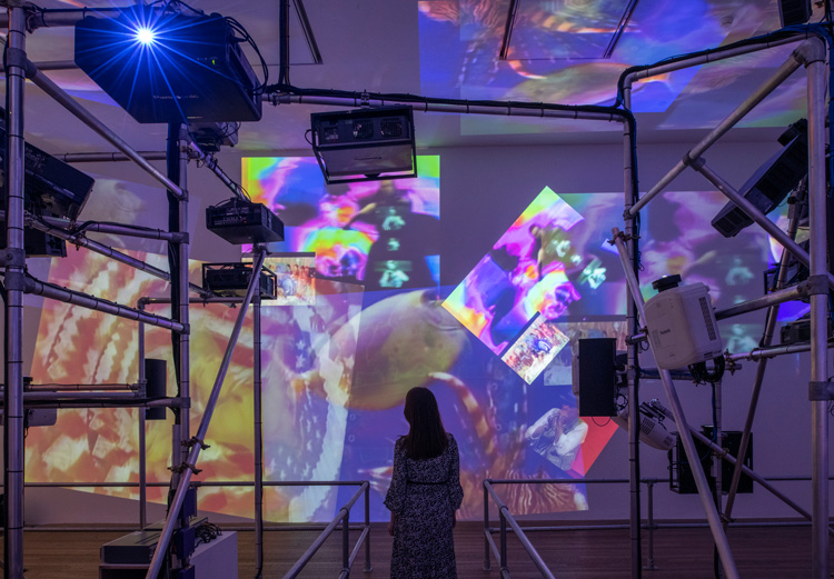 Nam June Paik. Sistine Chapel 1993. Installation view, Tate Modern 2019. Medium Video projectors, metal, wood, custom video switchers and four video channels, colour, sound. Courtesy of the Estate of Nam June Paik. Photo: © Tate (Andrew Dunkley).