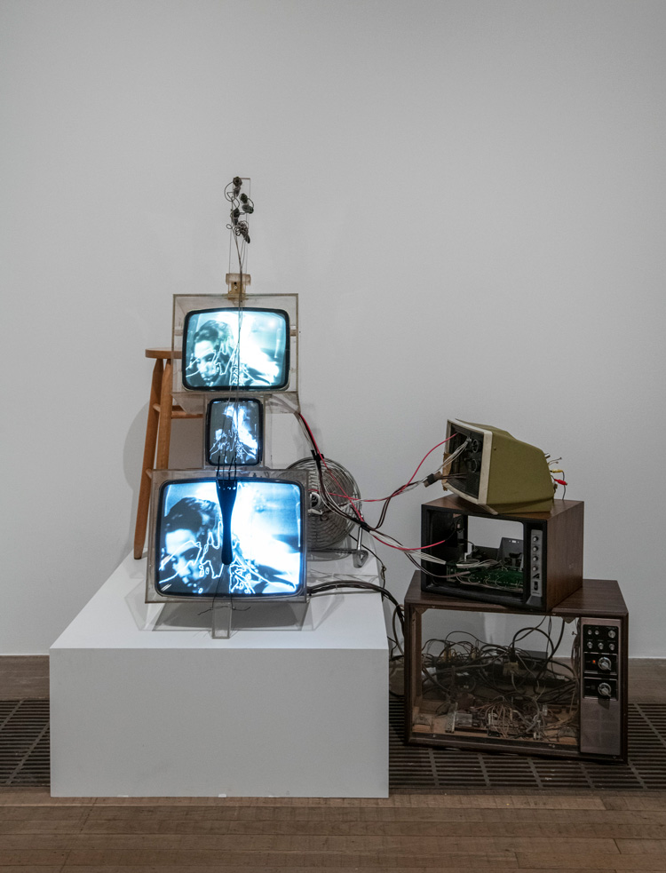 Nam June Paik. TV Cello 1971. Installation view, Tate Modern 2019. Three cathode-ray tubes, acrylic boxes, three television casings, electronics, wiring, wood base, fan and stool. Walker Art Center, T. B. Walker Acquisition Fund, 1992, Minneapolis. Formerly the collection of Otto Piene and Elizabeth Goldring, Massachusetts. Photo: © Tate (Andrew Dunkley). Photo: © Tate (Andrew Dunkley).