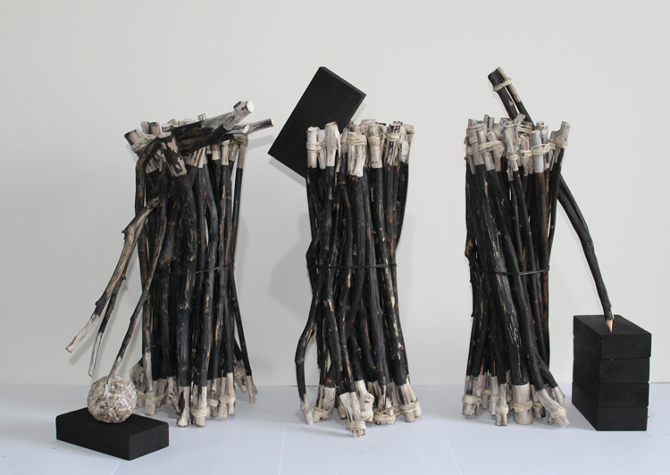 John Newling. Burnt sticks, 2020. Burnt sticks, elastic bands and charcoal blocks. Installation view, Ikon Gallery, 2020.