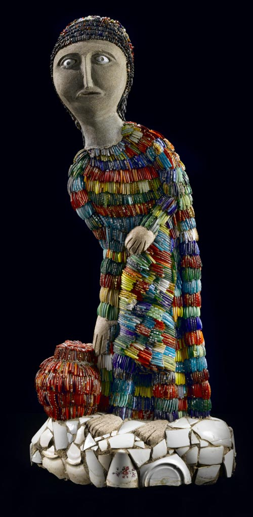 Nek Chand (b. 1924). <em>Lady Fetching Water</em>, c. 1984. Concrete over metal armature with mixed media 32 x 11 x 4 in. Collection American Folk Art Museum, New York. Gift of The National Children's Museum in honor of Gerard C. Wertkin 2004.25.11. Photo by Gavin Ashworth.