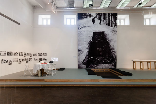 On Liteinyi, performance by Igor Panin 29 June 1996 and Movement of Tea Table toward Sunset, a Seven-Day Journey, performance 25 August 1996 by Igor Panin, Sergei Spirikhin, Vadim Fliagin, Alexander Liashko. Installation view at MMoMA © Mikhail Grigoriev.