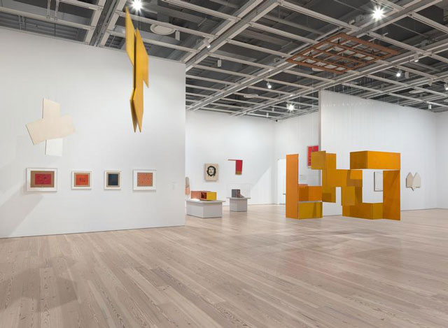 Installation view of  Hélio Oiticica: To Organise Delirium  (Whitney Museum of American Art, New York, July 14–October 1, 2017). From left to right, top to bottom:  P41 Bilateral, Teman (P41 Bilateral, Teman), 1959;  P52 Spatial Relief (P52 Relevo espacial), 1960;  Grupo Frente, ca. 1955;  Grupo Frente, ca. 1955;  Grupo Frente 136, 1956;  Grupo Frente 73, 1955-56;  Grupo Frente, ca. 1955  P31 Parangolé Cape 24, Escrerbuto, 1972;  B16 Box Bólide 12, Archaeological (B16 Bólide caixa 12, Arqueológico), 1964-65;  P20 Parangolé Cape 16, Guevarcália (P20 Parangolé capa 16, Guevarcália), 1968;  B33 Box Bólide 18, Homage to Cara de Cavalo (B33 Bólide caixa 18 Homenagem á Cara de Cavalo), 1965-66;  NC6 Medium Nucleus 3 (NC6 Núcleo médio 3), 1961-63;  P34 White Painting (P34 Série branca), 1959. Photograph by Ron Amstutz