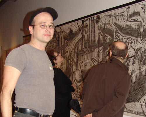 "Chris Hipkiss in front of ""Lonely Europe Arm Yourself,"" 1994 -1995, Pencil and ink on paper, 5 x 35'. Photo by Miguel Angel"