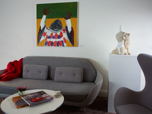 Clockwise from centre: Sofa by Jaime Hayon, oil painting by Carla Busuttil and  'Jean-PaulGaultier-Classique (ArticFox)' by Steve Bishop.