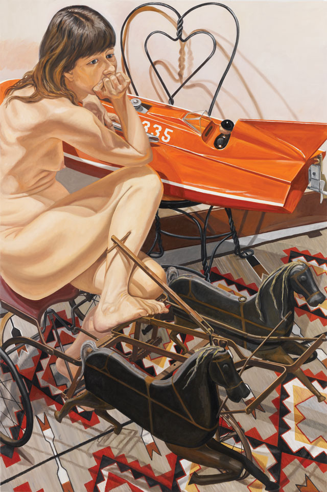 Philip Pearlstein. Model with Speedboat and Kiddie Car Harness Racer, 2010. Oil on canvas, 72 x 48 in (182.88 x 121.92 cm). © the artist.