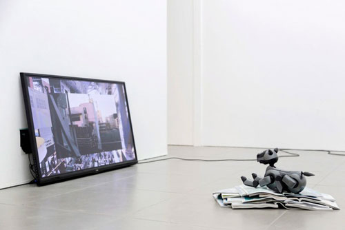 Yuri Pattison. Aibo Overcoming Modernity, 2014. Programmed Sony AIBO (Artificial Intelligence Robot, homonymous with aibō, (pal or partner in Japanese) entertainment robot, static cling sticker, inflight magazines.