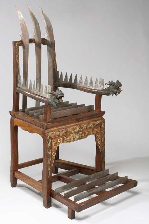 Torture chair. Wood with 12 steel blades, Chinese, 18th-19th century. 
