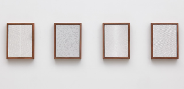 Anthony Pearson. Untitled (Four Part Etched Plaster), 2015. Pigmented hydrocal and medium coated pigmented hydrocal in walnut frames, each: 31.8 x 24.1 x 4.4 cm (12 1/2 x 9 1/2 x 1 3/4 in). Courtesy of the artist and Marianne Boesky Gallery, New York. © Anthony Pearson. Photograph: Lee Thompson.