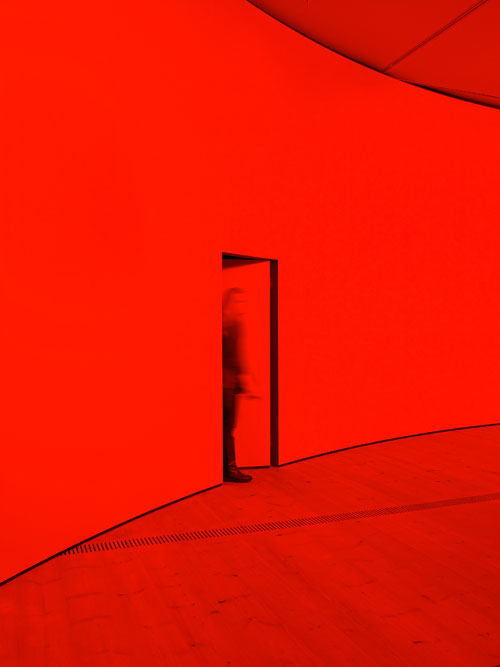 Gail Pickering. She was a Visitor, 2014. Installation view (2). Architectural installation incorporating cyclorama wall, red lights. Courtesy of the artist and BALTIC. © Gail Pickering. Photograph: John McKenzie.
