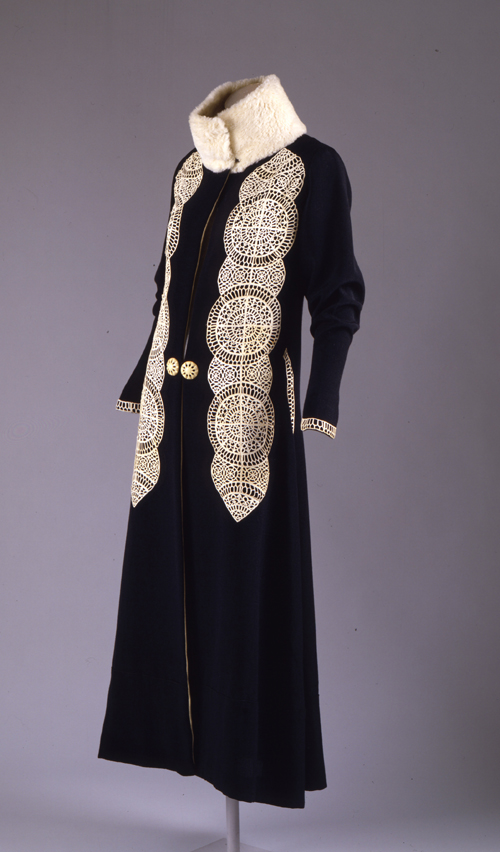 Paul Poiret (French, 1879–1944). Coat, ca. 1919. Black silk and wool rep weave with white kid cutwork appliqué and white broadtail trim. The Metropolitan Museum of Art, Gift of Mrs. David J. Colton, 1961